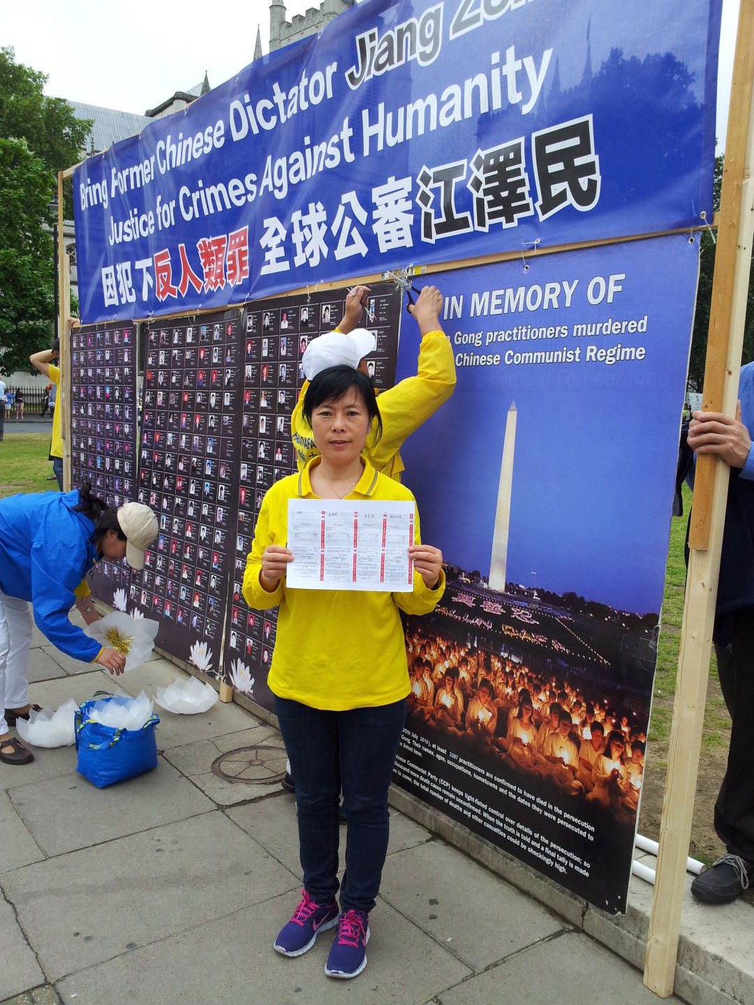 Mary-holds-the-receipt-of-a-recorded-letter-suing-Jiang-at-the-Parliament-Square-London