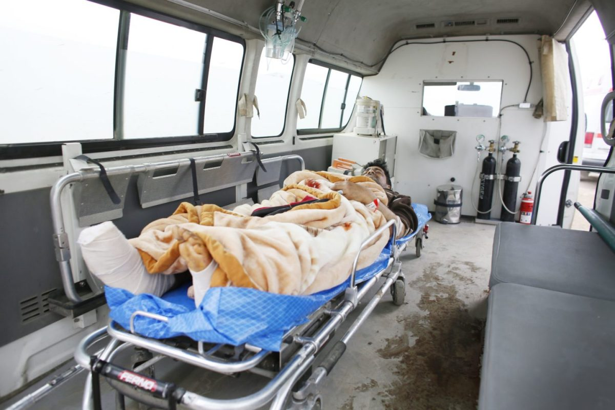 Injured man from Mosul in ambulance