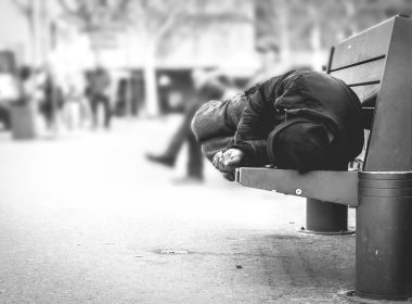 Person sleeping on bench
