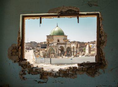 The Mosque of al-Nuri seen through a damaged window - West Mosul