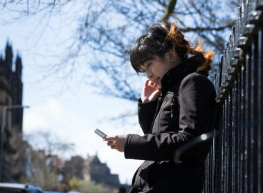 Young women on phone in Edinburgh